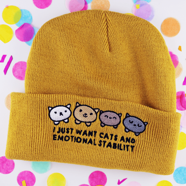 Cute and funny beanie hat in mustard yellow